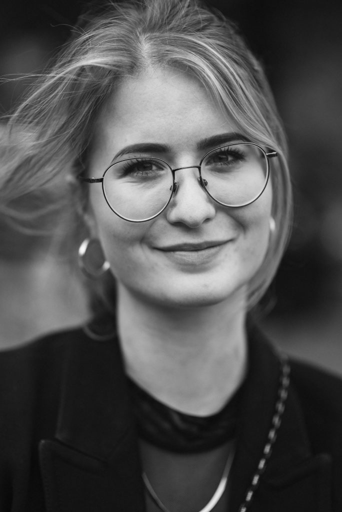 Black and white portrait of girl with glasses