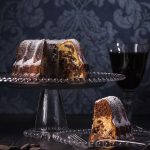 a single portion of marble bunt cake with a glass of wine