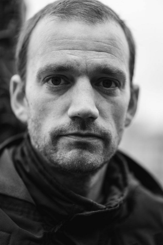 Black and White street portrait of man with stubble