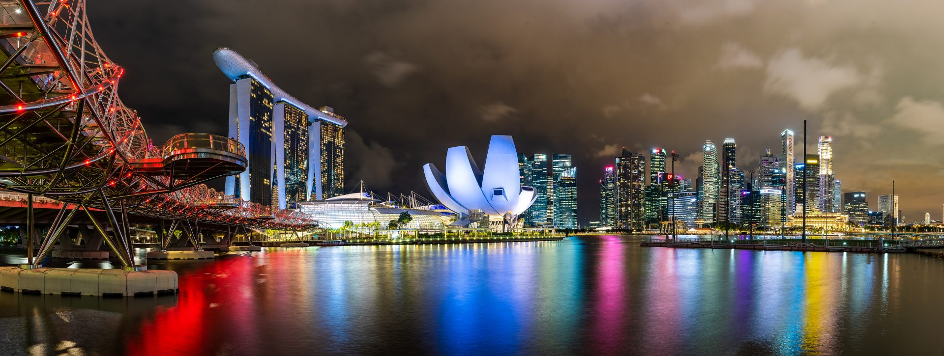 panoramic of Singapore Marina Bay Sands at night with colour lights