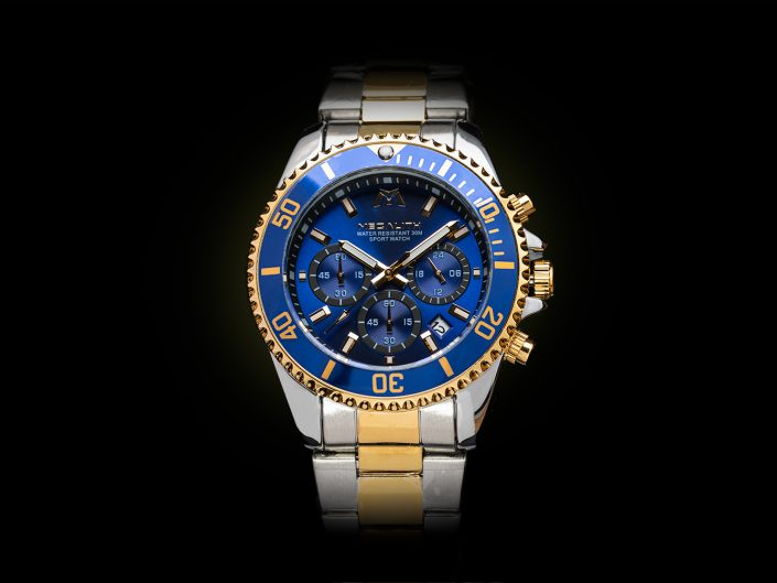 Blue faced chronograph watch with silver and gold strap on black background