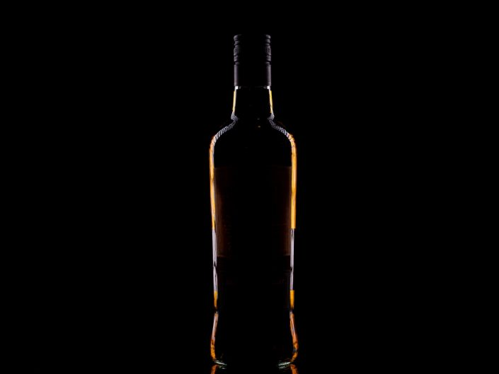 Black silhouette of a bottle with highlighted sides