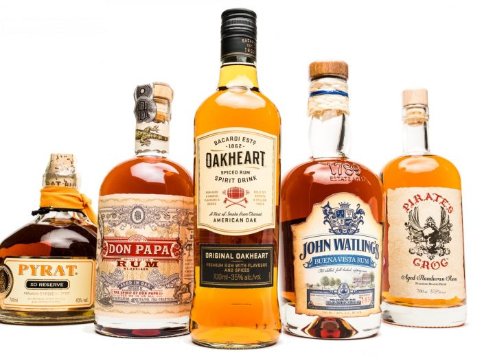 5 Bottles of spiced rum from around the world on a white background