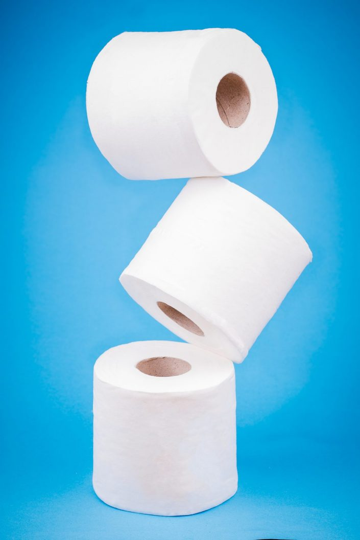 3 toilet rolls floating on a blue background