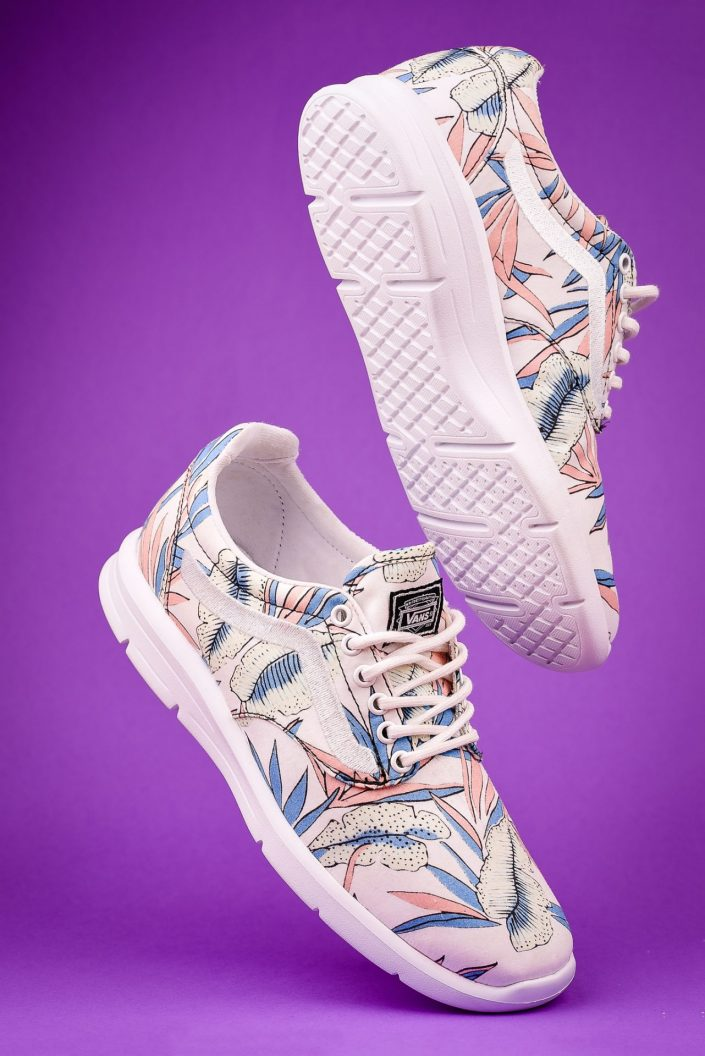Floral Vans trainers floating on a purple background